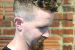 Clipper cut fade with textured hair on top